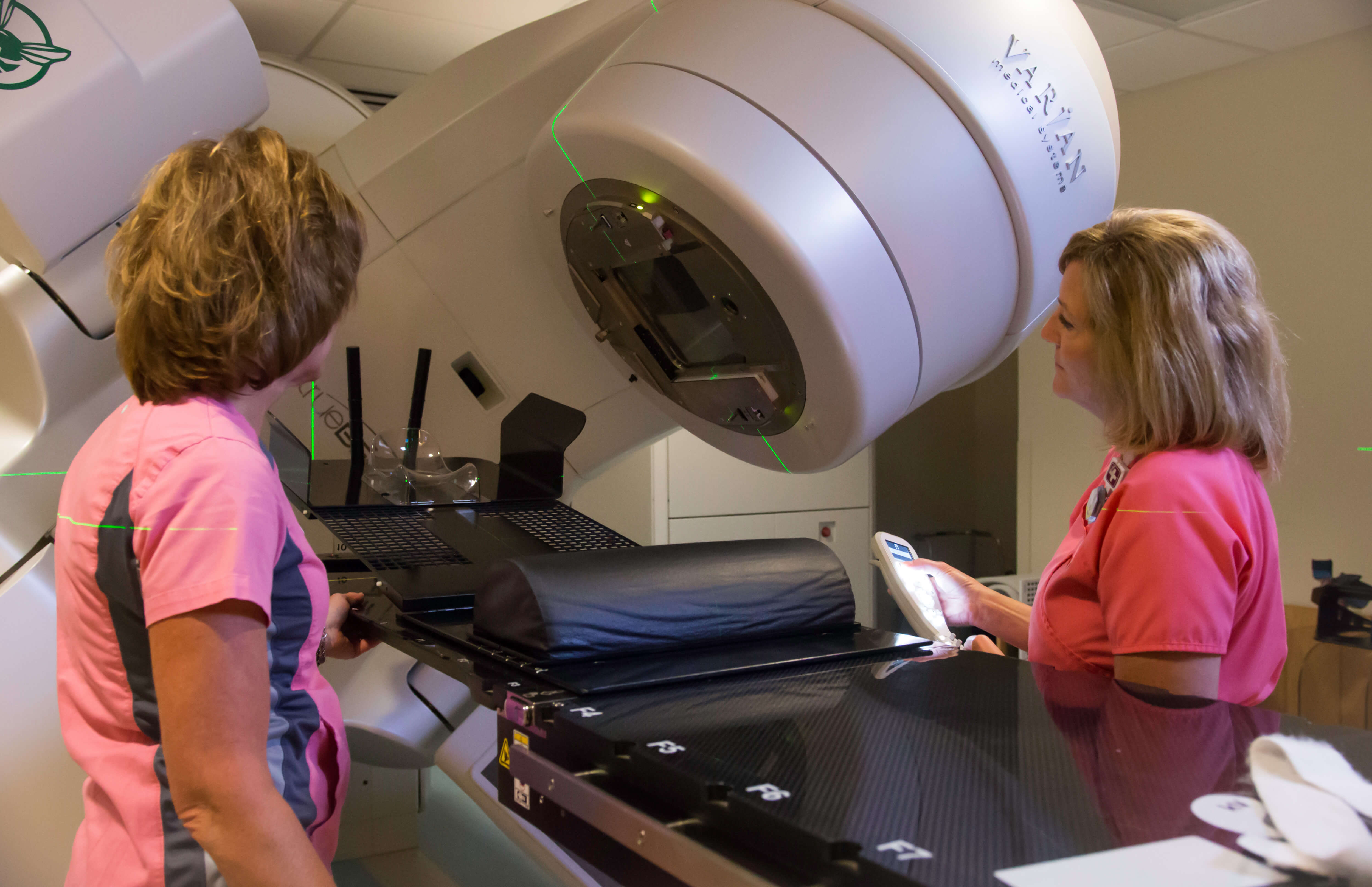 nurses using the varian radiation therapy machine